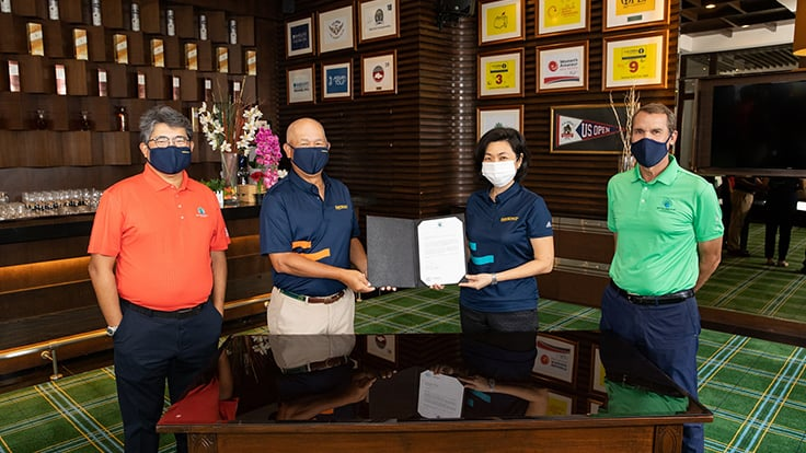 Sentosa Golf Club president Andrew Lim, Sentosa Development Corporation chairman Bob Tan and CEO Thien Kwee Eng, and SGC general manager and director of agronomy Andrew Johnston display the club's signing of the UN's Sports for Climate Action Initiative.