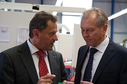 Georg Eckerle, managing director of InovaTools, talks with Rollomatic CEO Michel Rollier (on the right).