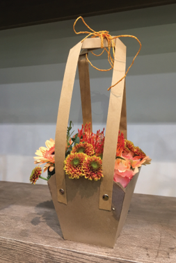 An example of the neutral, rustic plant packaging