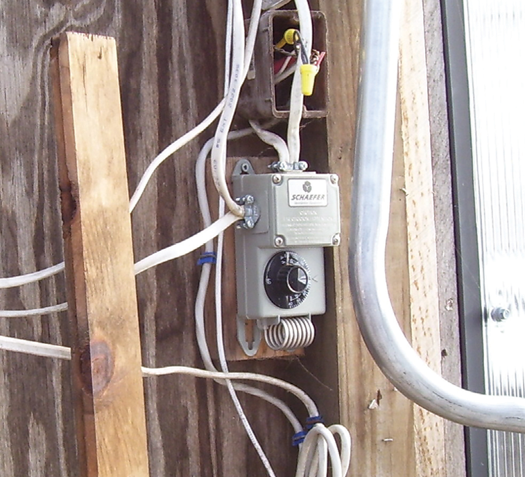 thermostat and outlet box with exposed wire splices and non-waterproof  wiring