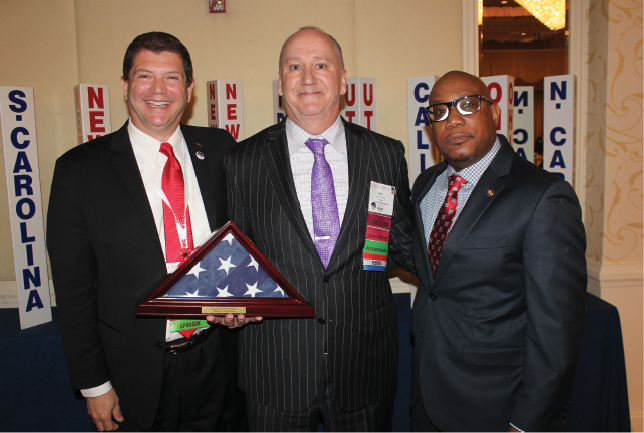 FMC's Steve Fasano (left) and Arnold Ramsey (right) with PestVets Veteran of the Year Marty Overline (center).