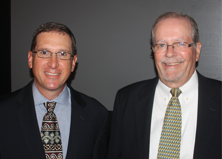 Rich Kalik (left) and Gary Curl, Specialty Consultants, before their presentations about the U.S. pest control market.