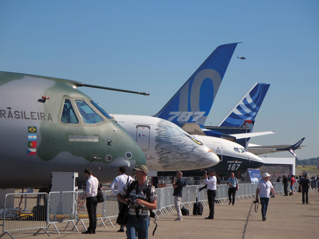 Static display line with Embraer KC-390 and E-196 E2, Boeing 737 MAX 9 and 787-10, and Airbus A380plus.