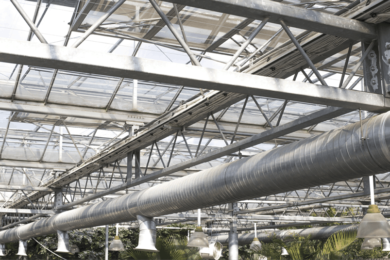 Greenhouses located in cold climates produce more greenhouse gases due to their increased heating needs.